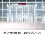 empty glass door in office... | Shutterstock . vector #1049907707