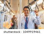 an asian businessman is... | Shutterstock . vector #1049919461