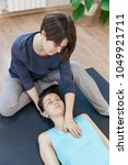 trainer doing special therapy... | Shutterstock . vector #1049921711