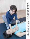trainer doing special therapy... | Shutterstock . vector #1049921717