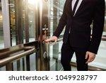 man pressing elevator button.... | Shutterstock . vector #1049928797