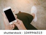 close up of  woman hands...   Shutterstock . vector #1049946515