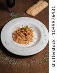 arrabiata pasta   italian food | Shutterstock . vector #1049976431