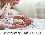 home portrait of a newborn baby ... | Shutterstock . vector #1050001421