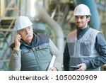 hesitant senior workman on... | Shutterstock . vector #1050020909