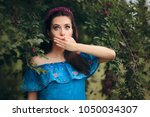 funny woman covering her mouth... | Shutterstock . vector #1050034307