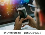 hands with the mobile phone on... | Shutterstock . vector #1050034337