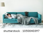 woman sleeping on the sofa | Shutterstock . vector #1050040397