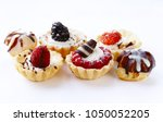 mini dessert tarts sweet... | Shutterstock . vector #1050052205