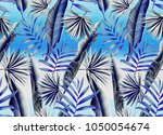 seamless tropical leaves and... | Shutterstock . vector #1050054674