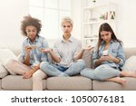 diverse female friends at home. ... | Shutterstock . vector #1050076181