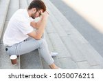 tired businessman is holding... | Shutterstock . vector #1050076211