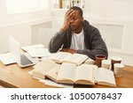 tired african american student... | Shutterstock . vector #1050078437