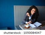 beautiful brunette sitting in...   Shutterstock . vector #1050084047