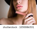 close up the blonde woman holds ...   Shutterstock . vector #1050086531