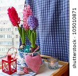Beauty hyacinths and lantern with a conflagration candle on a window in eve Advent - stock photo