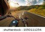 pov of motorbiker holding... | Shutterstock . vector #1050111254