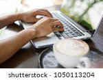 asian woman working in coffee... | Shutterstock . vector #1050113204