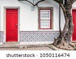 colorful wooden door in the... | Shutterstock . vector #1050116474