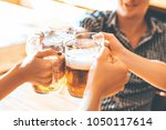 friends toasting with glasses... | Shutterstock . vector #1050117614