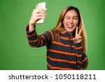 studio shot of young asian... | Shutterstock . vector #1050118211