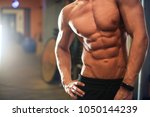 fit and muscular body  | Shutterstock . vector #1050144239