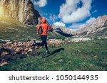 woman trail runner running on... | Shutterstock . vector #1050144935
