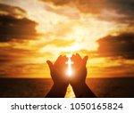 christian man with open hands... | Shutterstock . vector #1050165824