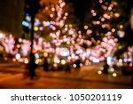 blurred and bokeh of pink led... | Shutterstock . vector #1050201119
