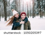 loving couple in the woods in... | Shutterstock . vector #1050205397