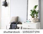 stylish hallway interior with... | Shutterstock . vector #1050207194
