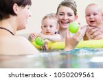 mums being happy about their... | Shutterstock . vector #1050209561