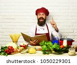 man with beard holds recipe...   Shutterstock . vector #1050229301