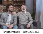 happy adult son and senior... | Shutterstock . vector #1050233561