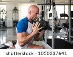 strong man in the gym...   Shutterstock . vector #1050237641