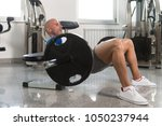 strong man in the gym...   Shutterstock . vector #1050237944