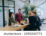 cropped shot of four colleagues ... | Shutterstock . vector #1050242771