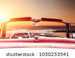 summer time and car on beach.... | Shutterstock . vector #1050253541