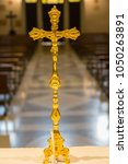 The Golden Crucifix On The...