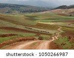 zig zag road pass trough... | Shutterstock . vector #1050266987