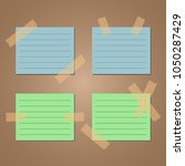 green and blue sticky note with ... | Shutterstock .eps vector #1050287429