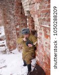 Small photo of Fighter of Red army with the PPSh machine gun in ruins of Stalingrad (a staff of a division of Lyudnikov)