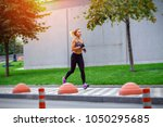 a beautiful sporty woman runing ... | Shutterstock . vector #1050295685