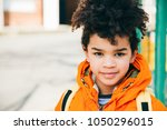 portrait of a happy little... | Shutterstock . vector #1050296015