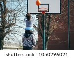 happy father holding on... | Shutterstock . vector #1050296021