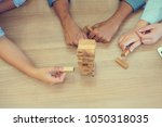 close up on woman hand playing... | Shutterstock . vector #1050318035