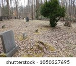 Cemetery With Gravestones And...