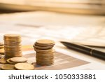 stack coin money with report... | Shutterstock . vector #1050333881