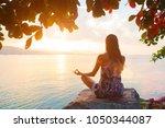 woman back side meditating...   Shutterstock . vector #1050344087