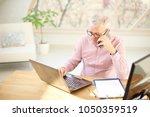high angle shot of elderly... | Shutterstock . vector #1050359519